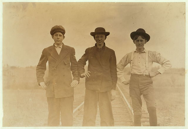 Types of adolescents. Boys working in Eureka Cotton Mills, Chester, S.C. Rob Dover--(Tallest boy). Been in mill eight or nine years. Melvin Reilly (next). In mill one year. Boyd McKowan (shortest boy). About 15 years old. Been in mill 5 years. Sunday, Nov. 29, 08. Witness Sara R. Hine.  Location: Chester, South Carolina / Photo by Lewis W. Hine.
