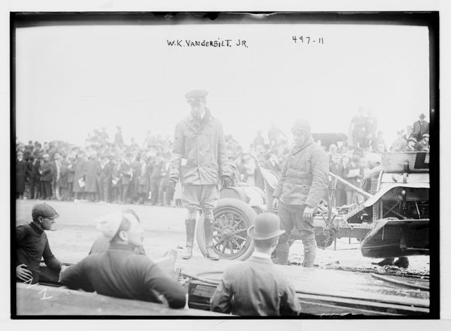 Vanderbilt Cup Auto Race, W.K. Vanderbilt Jr.'s standing in front of car on track