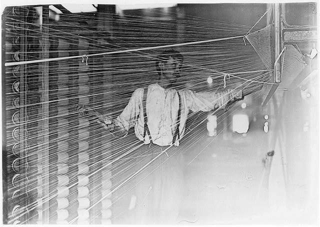 Warper at his machine, Newton, N.C.  Location: Newton, North Carolina.