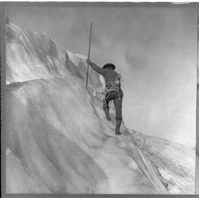 [Washington - Mount Rainier] Guide cutting steps on ice slope near summit