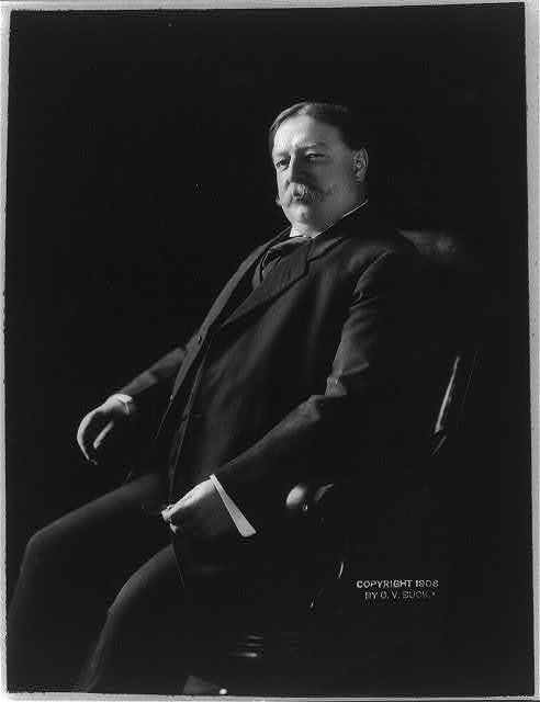 [William Howard Taft, three-quarters length, seated, facing left]