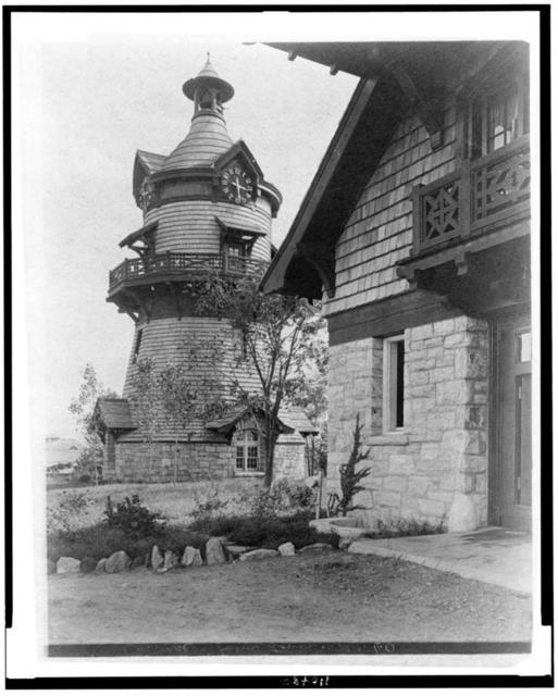 [Windmill-shaped clock tower at left, and part of garage of Edmund Cogswell Converse at right, Greenwich, Connecticut]
