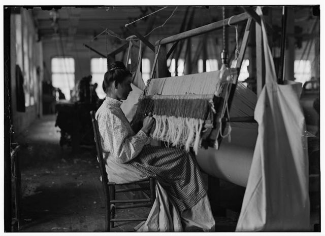 Woman at beam warper. Cherryville , N.C. Nov. 1908.  Location: Cherryville, North Carolina / Photo by Lewis W. Hine.