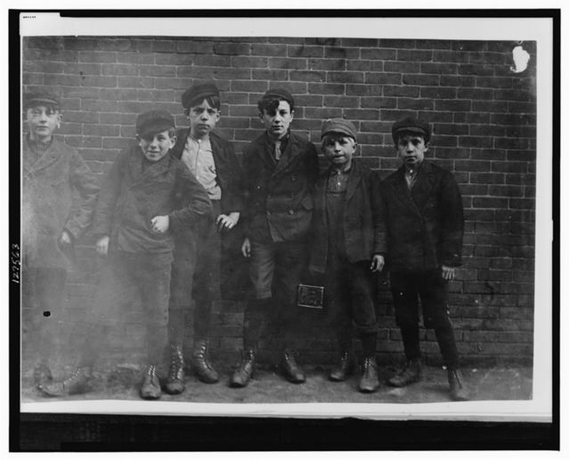 6 P.M. April 23, 1909. Sweepers, etc., in Hill and Bates Mills. Lewiston, Me. Boy next to right hand end is Jo. Been in Hill Mill 2 years (see photo 709). Only one or two could speak English.  Location: Lewiston, Maine.
