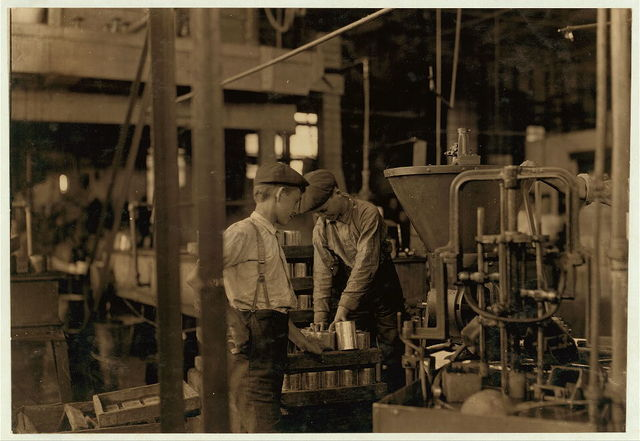 A canning machine and some of the boy[s] Small boys work at and around these machines some of which[?][ are dangerous. J. S. Farrand Packing Co., Baltimore, Md. Witness--J. W. Magruder. July 7, 1909.  Location: Baltimore, Maryland.