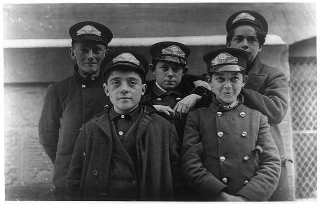 A few of the messengers Western Union, Hartford, Conn. They are on duty, alternate nights, until 10 P.M. (See label #592). Messenger #32 is Thomas De Lucco with him (in Tenderloin district) recorded in report to Committee.  Location: Hartford, Connecticut.
