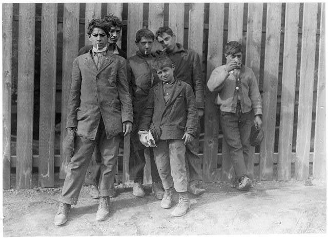 A group working on night shift at Hereford Glass Works, Cape May Court House, N.J. November 19, 1909. I saw the smalles[t] boy carrying in shortly before midnight, November 18th.  Location: Cape May Court House, New Jersey.