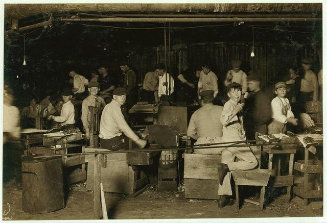 A midnight scene in More-Jonas [i.e., Jones?] Glass Works, Bridgeton, N.J. Four small boys are to be seen in this photo.  Location: Bridgeton, New Jersey.