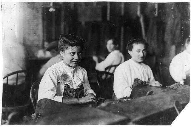 A Tampa, Fla., cigarmaker adolescent. Many beautiful girls and women in the business.  Location: Tampa, Florida.