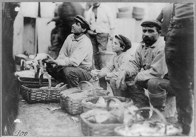"A Typical Fisher Boy at ""T"" Wharf. Boston.  Location: Boston, Massachusetts."