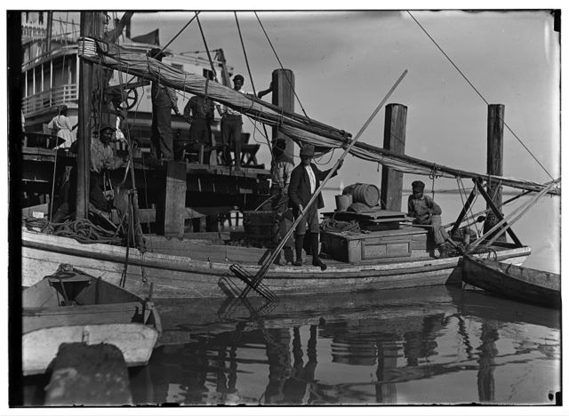 A young oyster fisher [?] Others smaller employed in busy season. Apalachicola, Fla. Randsey Summerford says he starts out at 4 A.M. one day, is out all night in the little oyster boat and back next day some time. Gets a share of the proceeds. Said he was 16 years old and been at it 4 years. Lives in Georgia and is here 6 months a year.  Location: Apalachicola, Florida.
