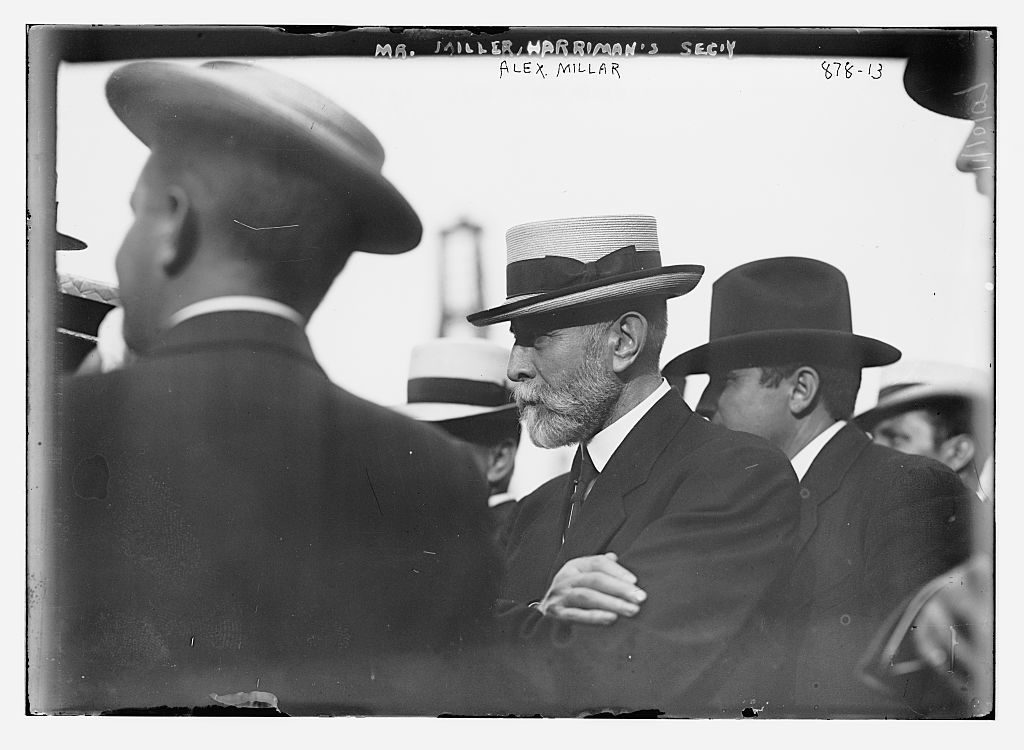 Alex. Miller, Harriman's secretary, with others