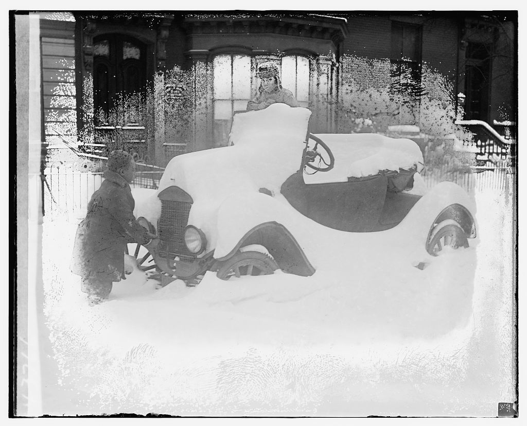 [Automobile covered in snow]