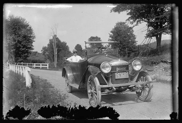 [Automobile driving on country road]