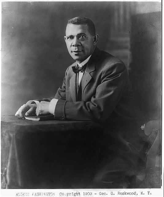 [Booker Taliaferro Washington, half-length, seated, facing left]