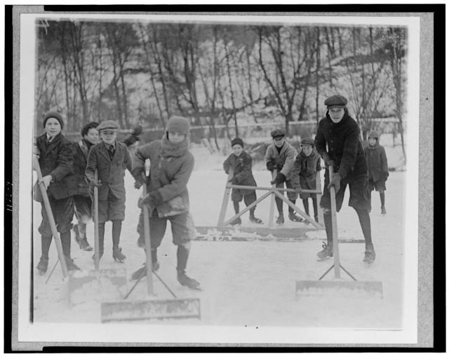[Boys cleaning snow off the ice, so that they can ice skate, Washington, D.C., area]