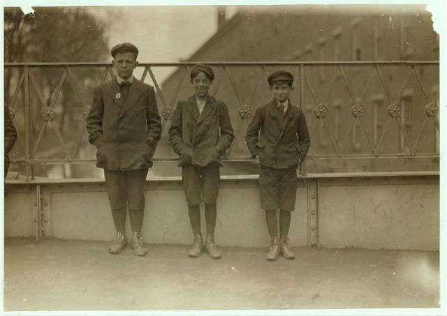 Boys working in Amoskeag Mills, Manchester, N.H. Smallest boy is Napoleon Cammery, 194 Merrimac St. Been in mill 1 year. Next boy is Jerry Moore, 352 Chestnut St. Martin Markey, 33 State St.  Location: Manchester, New Hampshire.
