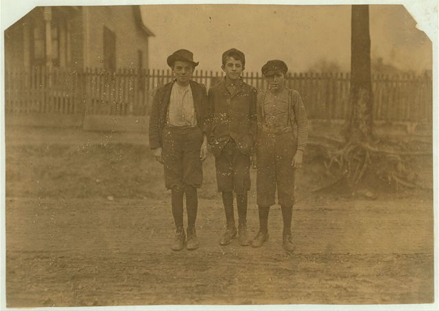 Boys working in Calvine Mfg. Co., Charlotte, N.C. Shortest boy been in mill work 3 years. Next boy 4 years. Tallest boy 5 years. Superintendent would not permit me to take photos in mill. I saw 10 or 15 children like these boys when they went home to dinner. Jan. 7, 1909.  Location: Charlotte, North Carolina / Photo by Lewis W. Hine.