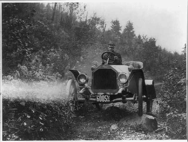 [Buick roadster on rocky country road]