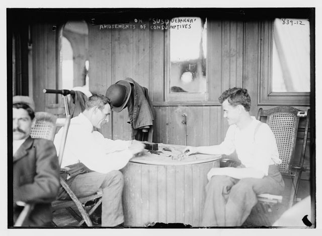 """Consumptives playing dominoes aboard """"Susquehanna"""", ferryboat used for tuberculosis camp"""