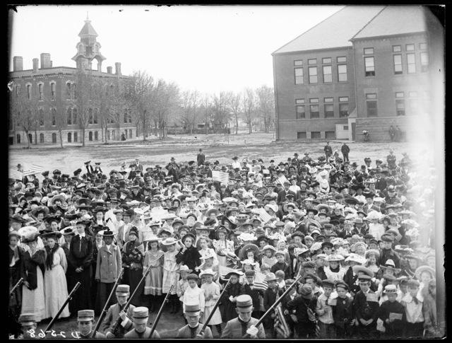 Crowd with the Kearney High School Building in the background.