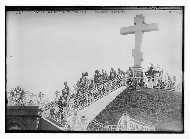 Czar and officials at service by grave for victims of Poltava, U.S.S.R.