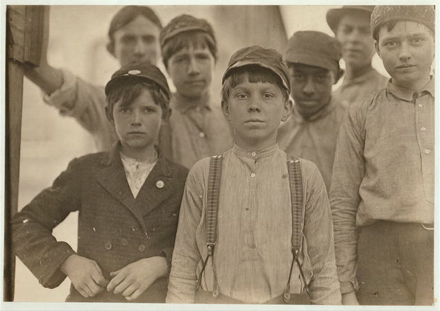 Doffers in Willingham Cotton Mill, Macon, Ga. The three boys in front row have been in mill work for 4, 5 and 6 years respectively.  Location: Macon, Georgia.