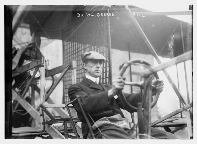 Dr. W. Greene, at pilot wheel of aeroplane