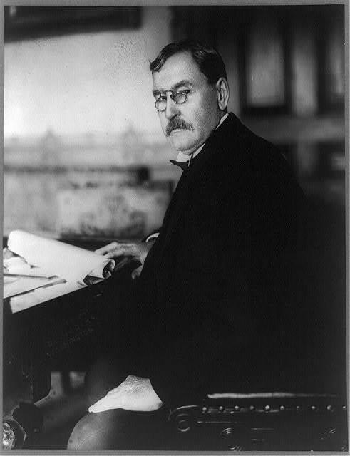 [E.J. Babcock, Private Secretary to Secretary of State, half-length portrait, seated at desk, facing left]