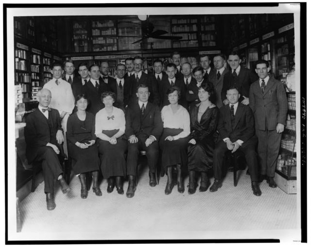 [Employees of People's Drug Store, Washington, D.C., standing and sitting in store]