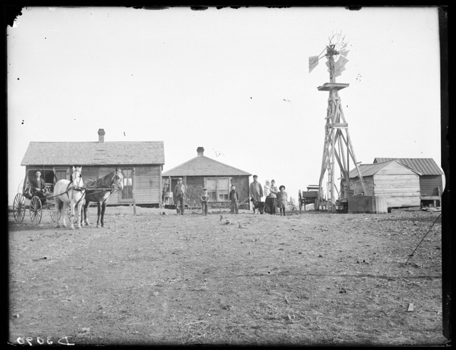 Family members standing in front of a sod and frame house on the Spellmeyer farm at Eddyville, Nebraska.