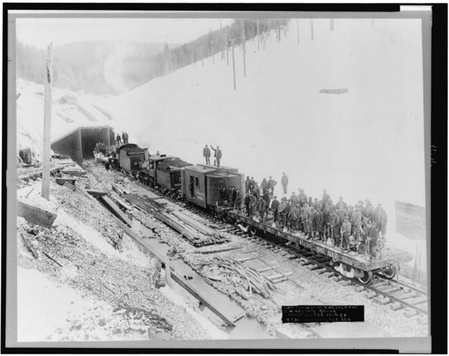 [First train going through the C.M. & St. P. Pass, Bitter Root Mountains, Idaho]