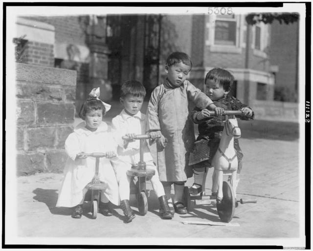[Four Oriental children, with small bicycles]