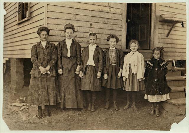 From Bibb Mill No. 1, Macon Ga. Smallest girl--Pampa Barrow, helper 1 yr. in mill. Next, Hellie Dix, helper 3 years in mill. Next, Ola Dix, helper 4 years in mill. Next, Minnie Lane, helper 1 year in mill. Next, Mammie Lane, Regular hand, 6 yrs. in mill. Next, Alma Cross helper, Regular hand, 3 yrs. in mill.  Location: Macon, Georgia.
