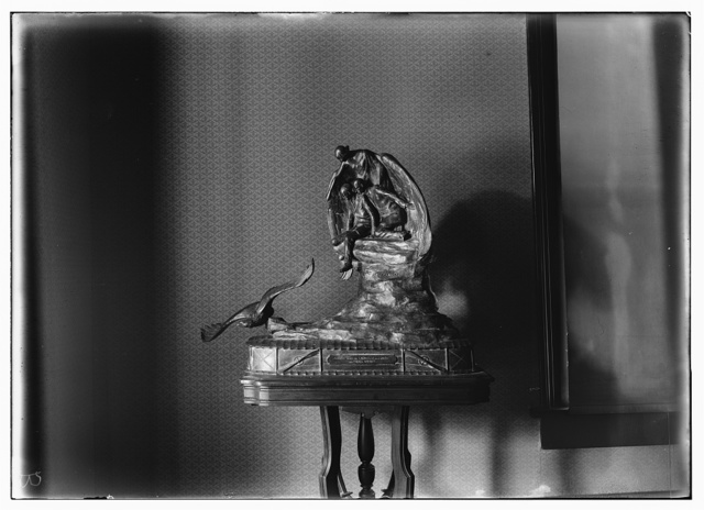 [Front view of the Muse of Aviation trophy as displayed on a table in Orville's home, Hawthorn Hill; Dayton, Ohio]