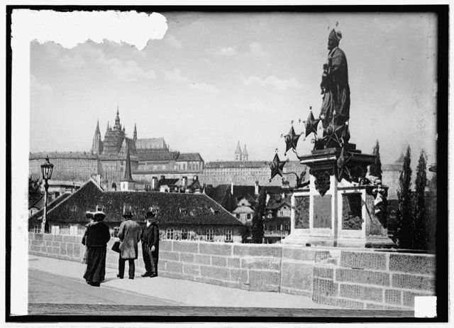 Germany, Prague. Statue to Patron Saint; Cathedral in background