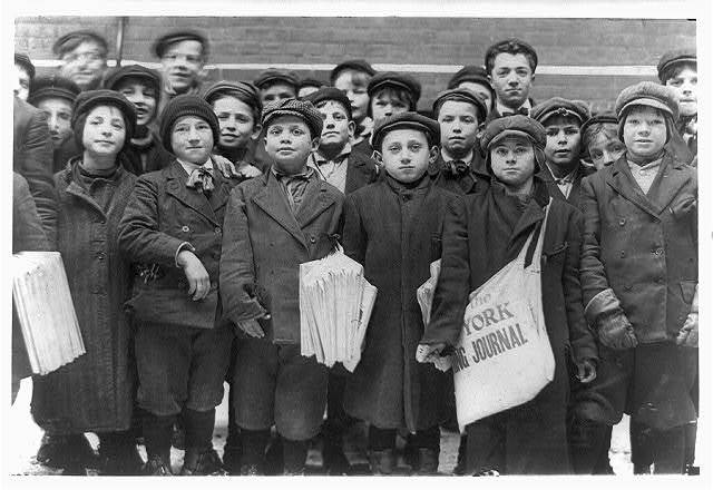 Group of newsboys at the Times Office, Hartford, Conn. The newsgirls mingle and jostle these boys in the office and in the yard.  Location: Hartford, Connecticut.