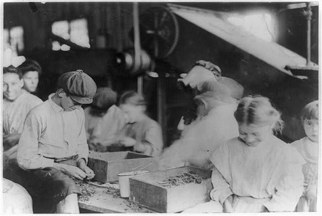 Group of workers stringing beans in J. S. Farrand Packing Company, Baltimore, Md. Many youngsters work here. Photo July 7, 1909.  Location: Baltimore, Maryland.