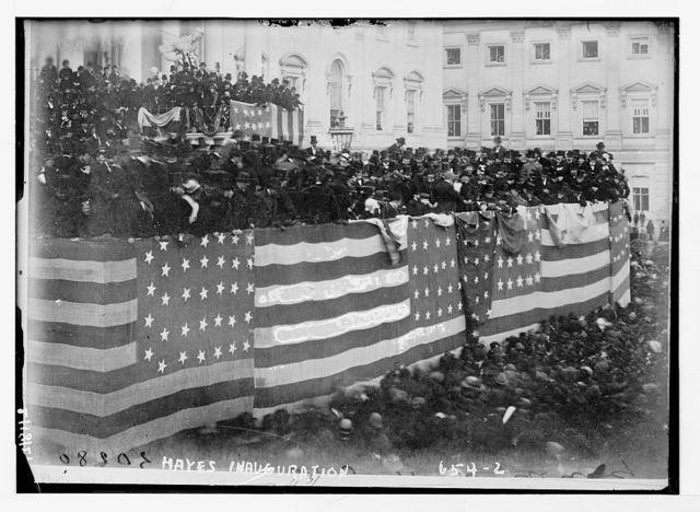 Hayes inauguration - flag bedecked podium and crowd
