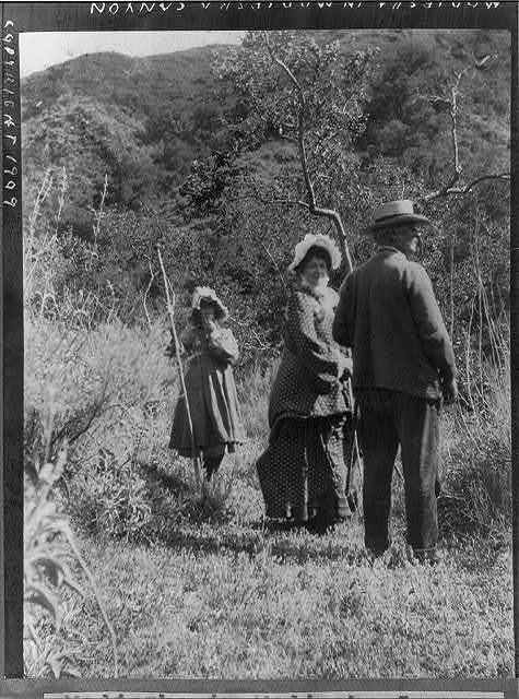 [Helena Modjeska, in Modjeska Canyon, Calif., with man and girl
