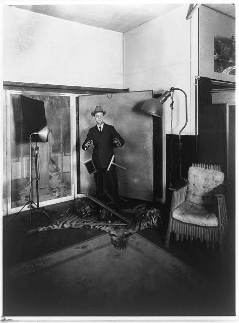 Herbert E. French, proprietor of the National Photo Co., posed in his Washington, D.C. studio