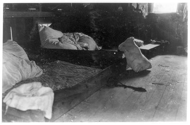 Interior of one family room in upper floor of one of the berry-pickers shacks, Bottomley's farm, near Baltimore.  Location: Baltimore, Maryland.