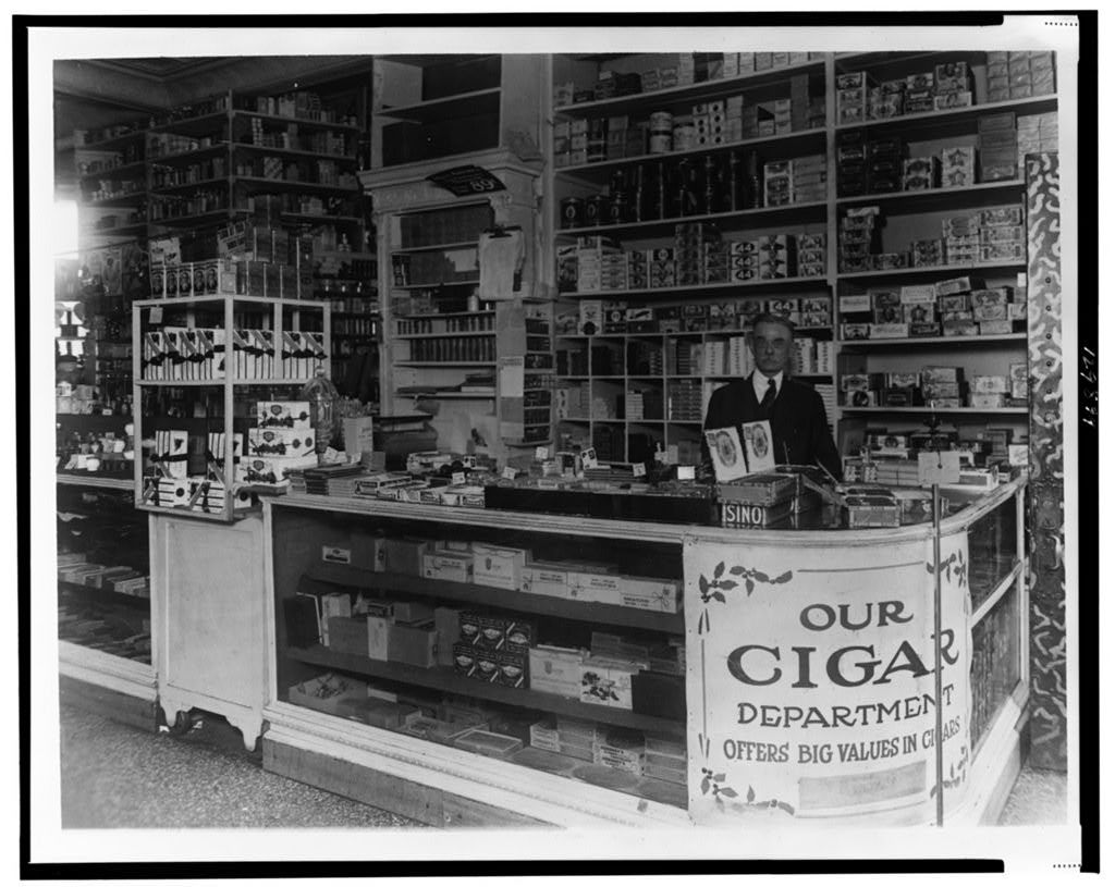 [Interior of People's Drug Store, 7th and M Streets, Washington, D.C., with employee behind counter with display of candy and cigars]