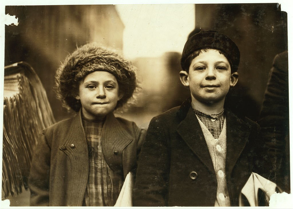 Joseph and Rosy, 10 and 8 yrs. old. He sells until evening. She is one of 5 or 6 girls who sell (afternoons) in Newark.  Location: Newark, New Jersey / Photo by Lewis W. Hine.