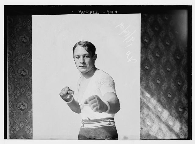 Ketchel, in boxing pose