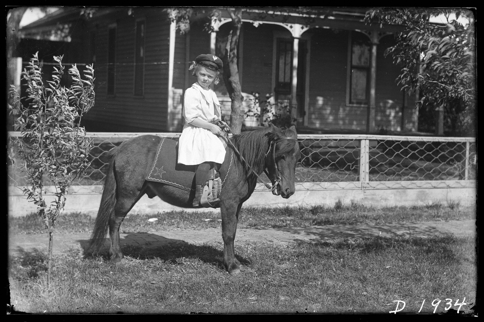 """Little Miss Mildred Fowler of Kearney, Nebraska, who won the pony, """"Fuzzy"""" and buggy in Ladies Home Journal contest"""