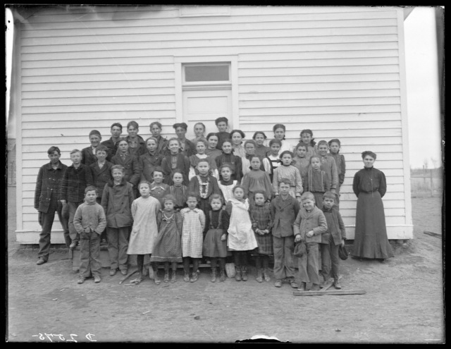 Louie Hollingworth and her students in front of her school in Buffalo County, Nebraska