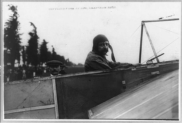 [Louis Blériot at the wheel of his monoplane, with Alfred LeBlanc, July 25, 1909]