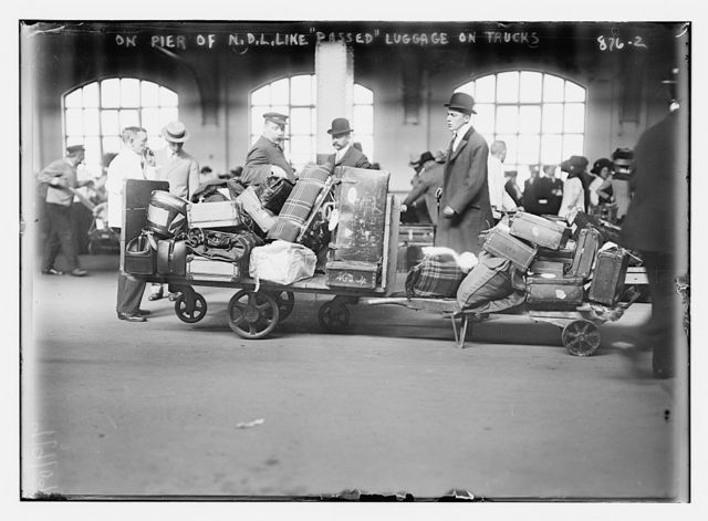 Luggage from boat on baggage carts, pier of N.D.L. Line
