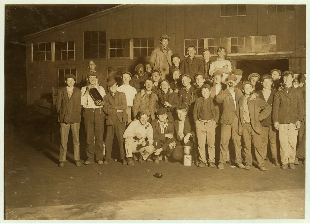 Lunch-time. A few of the workers on night shift in Cumberland Glass Works, Bridgeton, N.J.  Location: Bridgeton, New Jersey / Photo by Lewis W. Hine.